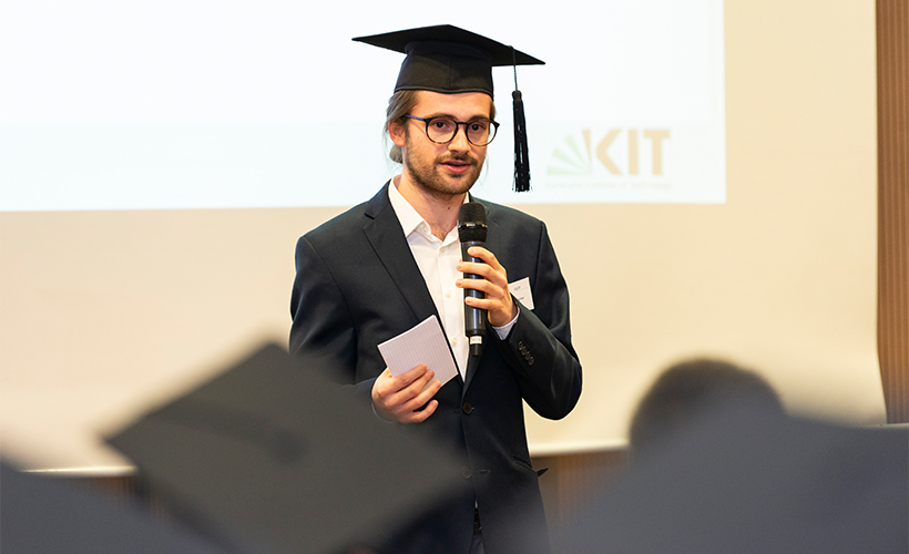 Graduate speaking at graduation